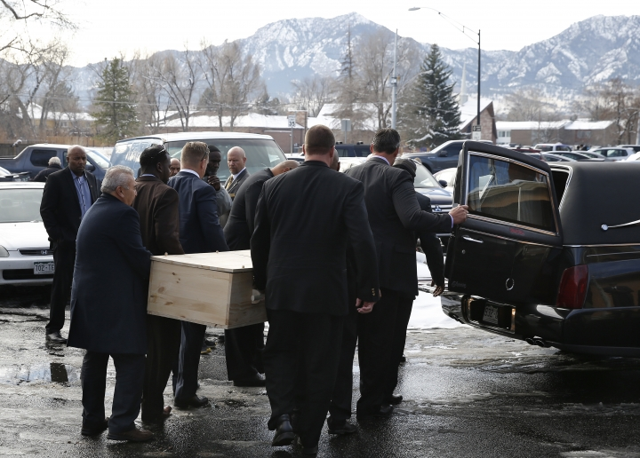 FILE - In this Dec. 9, 2016, file photo, pallbearers carry the casket for late Heisman Trophy winner and former Colorado running back Rashaan Salaam, following his funeral at the Islamic Center of Boulder, in Boulder, Colo. The Boulder County Coroner's Office said Thursday, Dec. 29, 2016, that Salaam died of a self-inflicted gunshot wound to the head. However, investigators weren't able to determine if he suffered chronic head trauma from playing football because his family didn't consent to those tests. (AP Photo/Brennan Linsley, File)