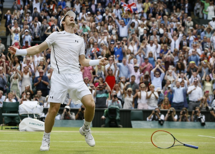 FILE - In this file photo dated Sunday, July 10, 2016, Andy Murray of Britain celebrates after beating Milos Raonic of Canada in the men's singles final at the Wimbledon Tennis Championships in London. Murray is to receive an OBE for services to tennis and charity, in the Queen's 2017 New Year honors. (AP Photo/Kirsty Wigglesworth, FILE)