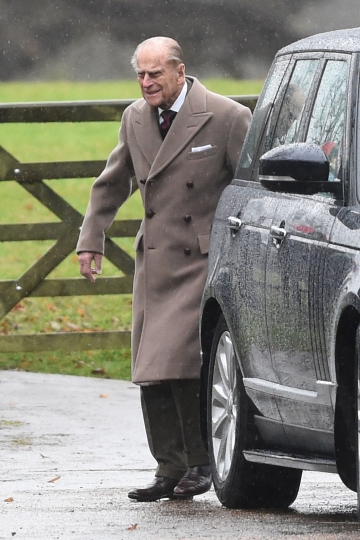 Britain's Prince Philip leaves St Mary Magdalene Church on the royal estate in Sandringham, eastern England, after attending a New Year's Day church service Sunday Jan. 1, 2017. Buckingham Palace said that Queen Elizabeth II will not be well enough to attend a New Year church service because of a lingering heavy cold. (Joe Giddens/PA via AP)