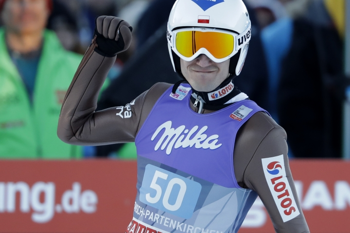 Second placed Kamil Stoch of Poland celebrates after his final jump at the second stage of the 65th four hills ski jumping tournament in Garmisch-Partenkirchen, Germany, Sunday, Jan. 1, 2017. (AP Photo/Matthias Schrader)