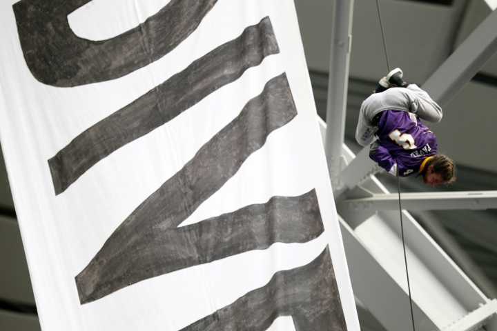 A protester against the Dakota Access Pipeline rappels from the catwalk in U.S. Bank Stadium during the first half of an NFL football game between the Minnesota Vikings and the Chicago Bears, Sunday, Jan. 1, 2017, in Minneapolis. (AP Photo/Andy Clayton-King)