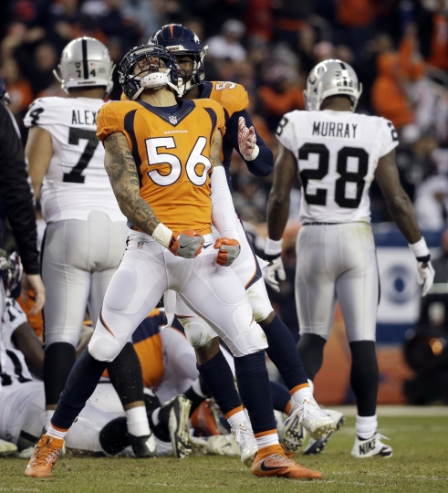 Denver Broncos outside linebacker Shane Ray celebrates after an Oakland Raiders fumble was recovered by the Broncos during the second half of an NFL football game, Sunday, Jan. 1, 2017, in Denver. (AP Photo/Jack Dempsey)