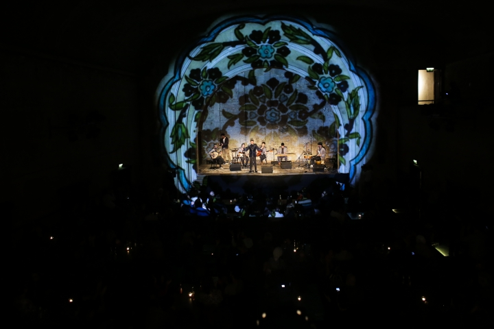 In this Dec. 18, 2016 picture, Musiqana, a Syrian band based in Berlin, perform during a concert marking their record release at the former silent movie cinema Delphi in Berlin. Musiqana draw both German and Syrian people to their concert of traditional Arab music, although the band admit it is difficult to perform while the humanitarian disaster in Aleppo continues to unfold. (AP Photo/Markus Schreiber)