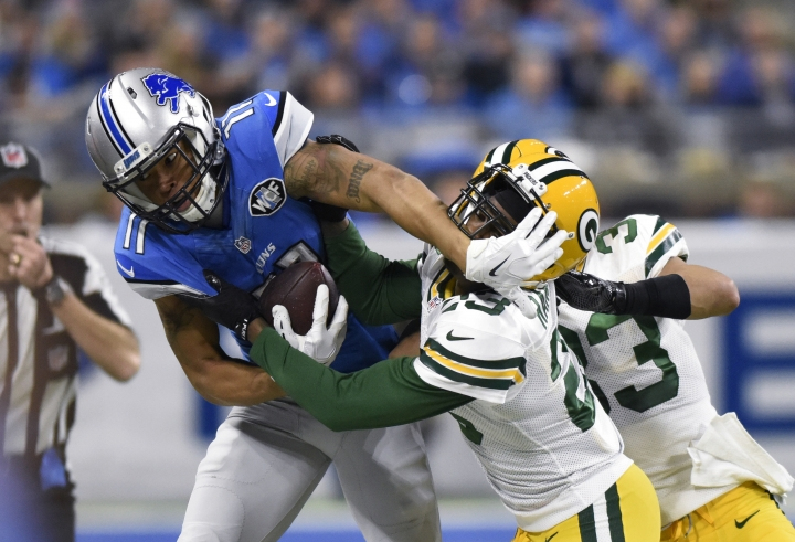 Detroit Lions wide receiver Marvin Jones is pushed out of bounds by Green Bay Packers cornerback Damarious Randall (23) during the first half of an NFL football game, Sunday, Jan. 1, 2017, in Detroit. (AP Photo/Jose Juarez)
