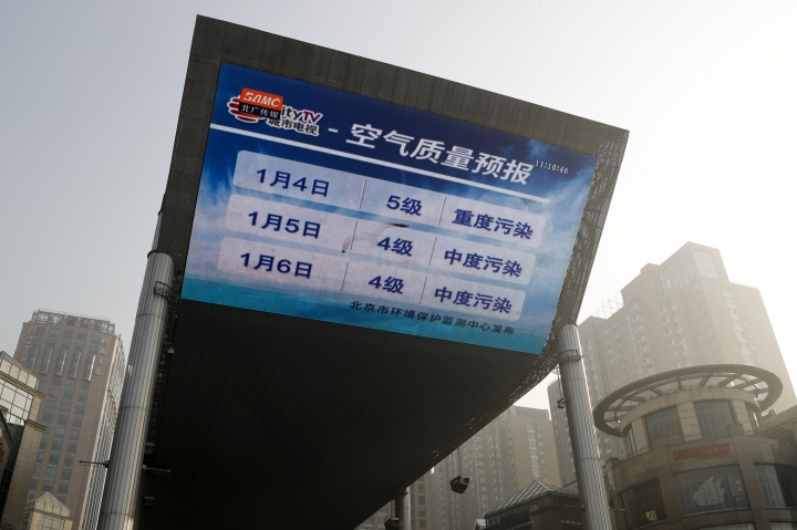 "A huge TV screen shows forecast of Beijing's air quality as the capital of China is blanked by heavy smog on Tuesday, Jan. 3, 2017. China's Ministry of Environment says an unspecified number of companies have violated measures meant to reduce smog as the country deals with a phase of particularly noxious pollution. Beijing has been on ""orange alert"" the second highest pollution alert level since Friday. The alert was originally due to end on Sunday but authorities have extended it a further three days. (AP Photo/Andy Wong)"