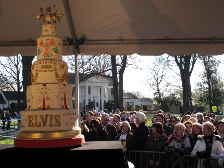 FILE - In this Tuesday, Jan. 8, 2013, file photo, fans of Elvis Presley attend a birthday celebration and cake-cutting on what would have been the late rock and roll icon's 78th birthday, at Graceland on in Memphis, Tenn. Events begin Thursday, Jan. 5, 2017, in Memphis, to mark what would have been Elvis Presley's 82nd birthday, with a cake-cutting ceremony on the front lawn of his home at Graceland. (AP Photo/Adrian Sainz, File)