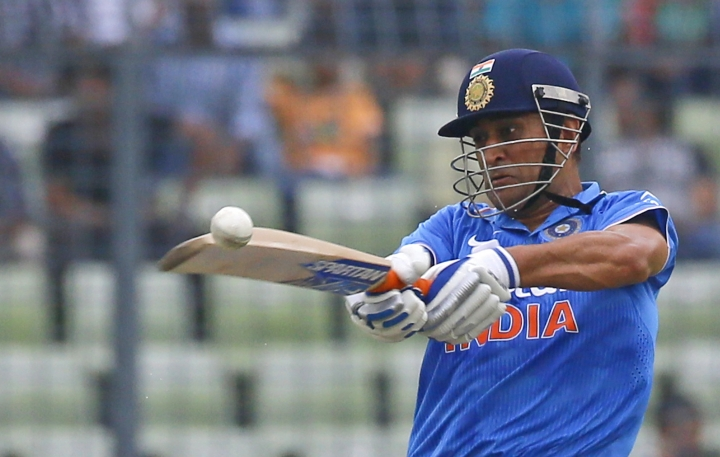 FILE - In this Wednesday, June 24, 2015 file photo, India's captain M S Dhoni plays a shot during the third one-day international cricket match against Bangladesh in Dhaka, Bangladesh. India's Mahendra Singh Dhoni has resigned as captain of the country's limited-over teams, India's cricket board said Wednesday Jan. 4, 2017. (AP Photo/A.M. Ahad, File)