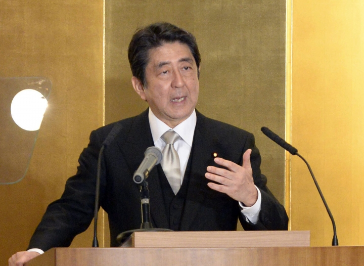 Japanese Prime Minister Shinzo Abe delivers his speech during New Year's press conference in Ise, central Japan, Wednesday, Jan. 4, 2017. (Takuya Inaba/Kyodo News via AP)