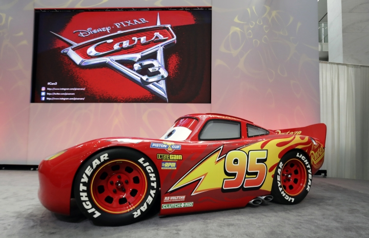 """An updated Lightning McQueen animated vehicle is unveiled during a news conference at the North American International Auto Show, Sunday, Jan. 8, 2017, in Detroit. The studios also unveiled an aggressive newcomer to Disney Pixar's """"Cars"""" series who challenges veteran Lightning McQueen. (AP Photo/Carlos Osorio)"""