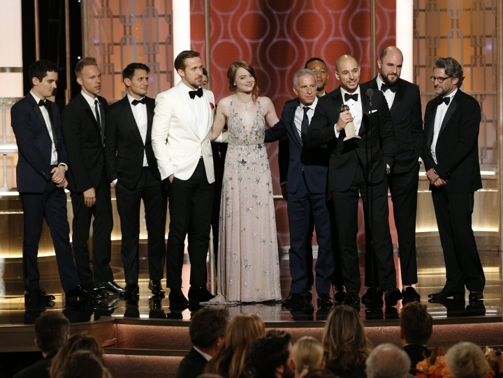 "This image released by NBC shows the cast and crew of ""La La Land"" winner of the award for best motion picture musical or comedy at the 74th Annual Golden Globe Awards at the Beverly Hilton Hotel in Beverly Hills, Calif., on Sunday, Jan. 8, 2017. (Paul Drinkwater/NBC via AP)"