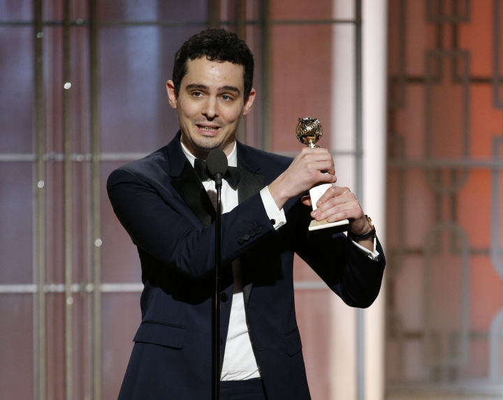 "This image released by NBC shows Damien Chazelle with the award for best screenplay for ""La La Land,"" at the 74th Annual Golden Globe Awards at the Beverly Hilton Hotel in Beverly Hills, Calif., on Sunday, Jan. 8, 2017. (Paul Drinkwater/NBC via AP)"