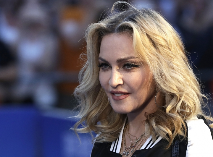 """FILE- In this Sept. 15, 2016, file photo, musician Madonna poses for photographers upon arrival at the World premiere of the film """"The Beatles, Eight Days a Week"""" in London. Madonna, Emma Stone, Willow Smith and first lady Michelle Obama are among 150 women chosen by editors of Harper's Bazaar as the world's most fashionable, the list was released Tuesday, Jan. 10, 2017. (AP Photo/Kirsty Wigglesworth, File)"""