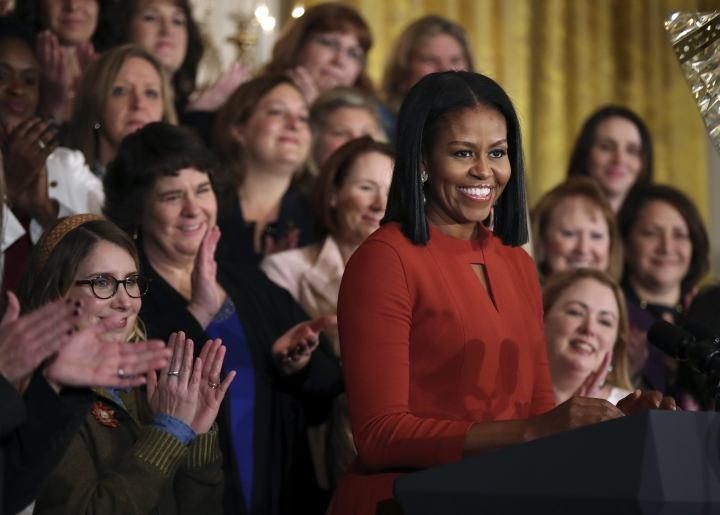 FILE- In this Jan. 6, 2017, file photo, First lady Michelle Obama smiles as she speaks at the 2017 School Counselor of the Year ceremony in the East Room of the White House in Washington. Madonna, Emma Stone, Willow Smith and the first lady are among 150 women chosen by editors of Harper's Bazaar as the world's most fashionable, the list was released Tuesday, Jan. 10, 2017. (AP Photo/Manuel Balce Ceneta, File)
