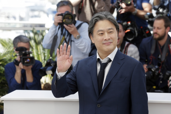 "FILE - In this Saturday, May 14, 2016 file photo, director Park Chan-Wook poses for photographers during a photo call for the film The Handmaiden at the 69th international film festival, Cannes, southern France. South Korean cinema has fared well in the nominations for the Asian Film Awards. Director Park Chan Wook's erotic period drama, ""The Handmaiden,"" received six nominations, including Moon So-ri for best supporting actress. Five nominations went to the zombie film, ""Train to Busan,"" including Ma Dong-seok for best supporting actor. (AP Photo/Lionel Cironneau, file)"