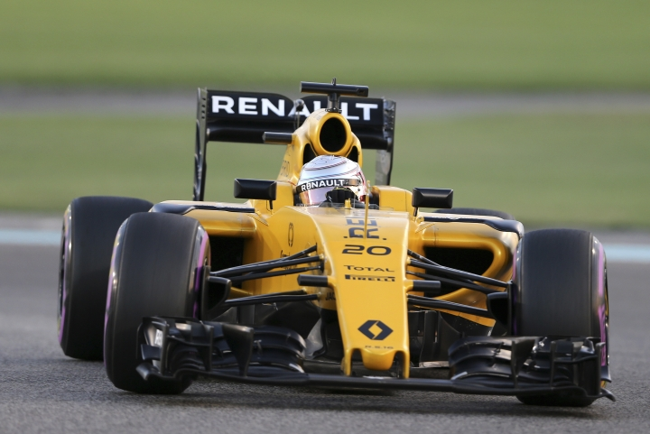FILE - In this file photo dated Saturday, Nov. 26, 2016, Renault driver Kevin Magnussen of Denmark takes a curve during the qualifying session at the Yas Marina racetrack in Abu Dhabi, United Arab Emirates. According to an announcement Wednesday Jan. 11, 2017, from Renault Frederic Vasseur has left his role as team principal of Renault by mutual consent, after one season with the Formula One team. (AP Photo/Kamran Jebreili, FILE)