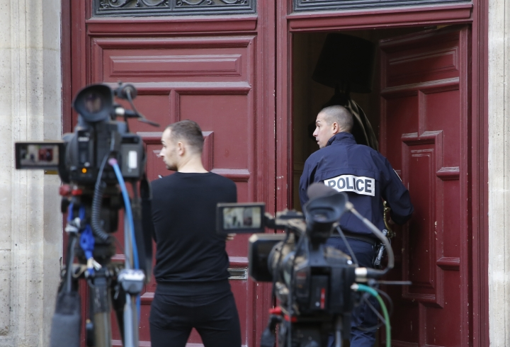 FILE - In this Oct.3, 2016 file photo, a French police officer enters the residence of Kim Kardashian West in Paris. Paris police Monday Jan.9, 2017 say 16 people have been arrested over Kim Kardashian jewelry heist. (AP Photo/Michel Euler, File)