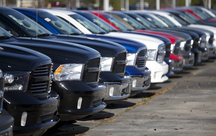 "FILE - In this Jan. 5, 2015, file photo, Ram pickup trucks are on display on the lot at Landmark Dodge Chrysler Jeep RAM in Morrow, Ga. On Thursday, Jan. 12, 2017, the U.S. government alleged that Fiat Chrysler Automobiles failed to disclose that software in some of its pickups and SUVs with diesel engines allows them to emit more pollution than allowed under the Clean Air Act. The Environmental Protection Agency said in a statement that it issued a ""notice of violation"" to the company that covers about 104,000 vehicles, including the 2014 through 2016 Jeep Grand Cherokee and Dodge Ram pickups, all with 3-liter diesel engines. (AP Photo/John Bazemore, File)"