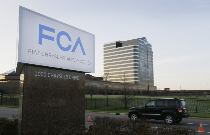 "FILE - In this Tuesday, May 6, 2014, file photo, a vehicle moves past a sign outside Fiat Chrysler Automobiles world headquarters in Auburn Hills, Mich. On Thursday, Jan. 12, 2017, the U.S. government alleged that Fiat Chrysler Automobiles failed to disclose that software in some of its pickups and SUVs with diesel engines allows them to emit more pollution than allowed under the Clean Air Act. The Environmental Protection Agency said in a statement that it issued a ""notice of violation"" to the company that covers about 104,000 vehicles, including the 2014 through 2016 Jeep Grand Cherokee and Dodge Ram pickups, all with 3-liter diesel engines. (AP Photo/Carlos Osorio, File)"
