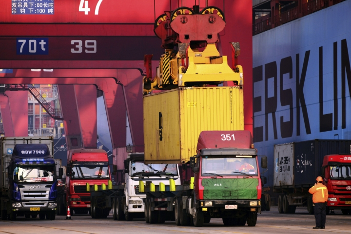 FILE - In this Dec. 8, 2016 file photo, trucks line up at a container port in Qingdao in east China's Shandong province. Customs data posted Friday, Jan. 13, 2017 showed that exports shrank 6.1 percent to $209.4 billion in December compared with the year-ago period. China's exports fell back into contraction again last month, signaling renewed weakness for the world's second biggest economy as it faces possible trade tensions under Donald Trump's presidency. (Chinatopix via AP, File)
