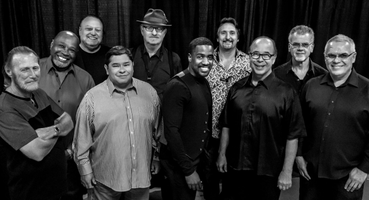 "This Aug. 2016 photo provided by courtesy of Tower of Power/Webster Public Relations, shows the band members from Tower of Power, from left, Rocco Prestia, Roger Smith, Sal Cracchiolo, Adolfo Acosta, Stephen ""Doc"" Kupka, Marcus Scott, Tom E. Politzer, Emilio Castillo, David Garibaldi, and Jerry Cortez. Two members of Tower of Power, a group that has been an R&B institution for nearly 50 years, were hit by a train Thursday night, Jan. 12, 2017, as they walked across tracks before a scheduled gig in their hometown of Oakland, Calif., but both survived, their manager said. Calling it an ""unfortunate accident,"" manager Jeremy Westby said in a statement that drummer Garibaldi and bass player Marc van Wageningen (not pictured) are ""responsive and being treated at a local hospital."" (Tower of Power/Webster Public Relations via AP)"