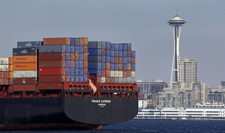 FILE - In this Feb. 15, 2015, file photo, the Space Needle towers in the background beyond a container ship anchored in Elliott Bay near downtown Seattle. A board member of the American Chamber of Commerce in China, Lester Ross, says China is preparing to retaliate if U.S. President-elect Donald Trump carries out promises to impose sanctions on Chinese goods. (AP Photo/Elaine Thompson, File)