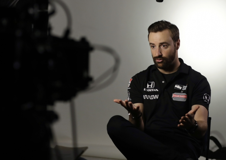 IndyCar Series driver James Hinchcliffe responds to a question during IndyCar Series annual media day Wednesday, Jan. 18, 2017, in Indianapolis. (AP Photo/Darron Cummings)
