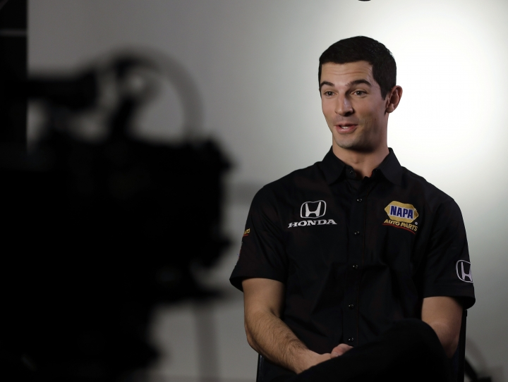 Defending Indianapolis 500 champion Alexander Rossi responds to a question during IndyCar Series annual media day Wednesday, Jan. 18, 2017, in Indianapolis. (AP Photo/Darron Cummings)