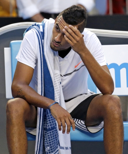Australia's Nick Kyrgios sits in his chair after losing the third set against Italy's Andreas Seppi during their second round match at the Australian Open tennis championships in Melbourne, Australia, Wednesday, Jan. 18, 2017. (AP Photo/Aaron Favila)