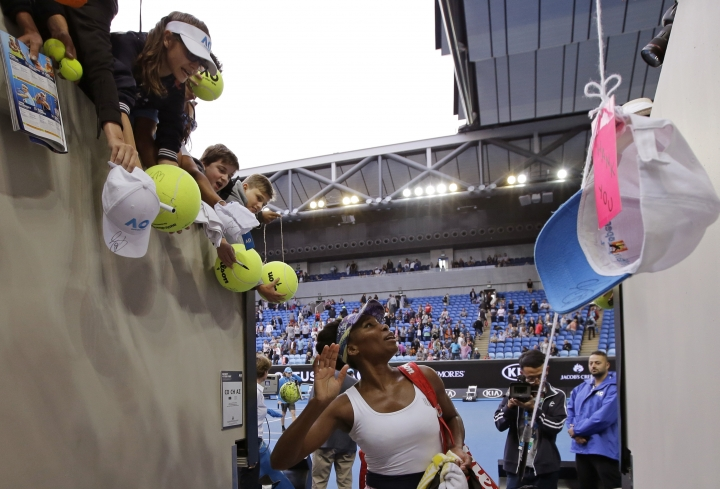 United States' Venus Williams waves to fans after winning over China's Duan Yingying during their third round match at the Australian Open tennis championships in Melbourne, Australia, Friday, Jan. 20, 2017. (AP Photo/Aaron Favila)