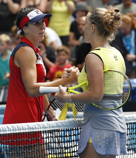 Russia's Svetlana Kuznetsova, right, is congratulated by Serbia's Jelena Jankovic during their third round match at the Australian Open tennis championships in Melbourne, Australia, Friday, Jan. 20, 2017. (AP Photo/Kin Cheung)