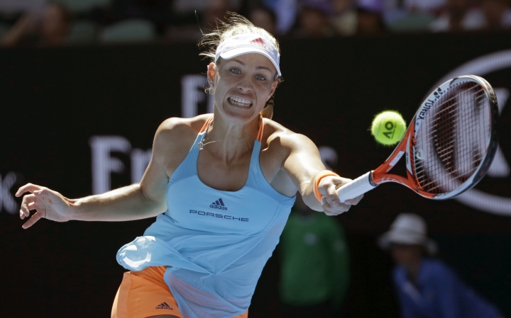 Germany's Angelique Kerber makes a forehand return to Kristyna Pliskova of the Czech Republic during their third round match at the Australian Open tennis championships in Melbourne, Australia, Friday, Jan. 20, 2017. (AP Photo/Dita Alangkara)