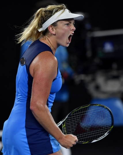 United States' Coco Vandeweghe celebrates a point win over Canada's Eugenie Bouchard during their third round match at the Australian Open tennis championships in Melbourne, Australia, Friday, Jan. 20, 2017. (AP Photo/Andy Brownbill)