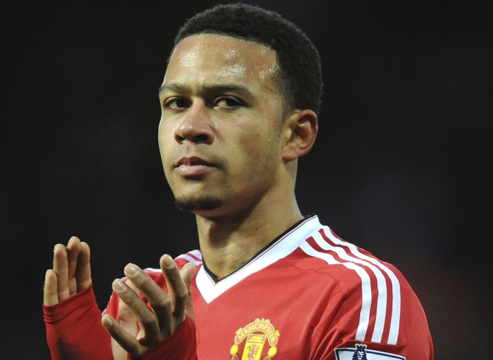 FILE- In this Sunday, March 6, 2016 file photo Manchester United's Memphis Depay applauds, during the English Premier League soccer match between West Bromwich Albion and Manchester United, at the Hawthorns in West Bromwich, England. Depay has completed his move from Manchester United to Lyon, joining the French club on a 4½-year contract. Depay, who will wear the No. 9 jersey, was presented on Friday, Jan. 20, 2017 alongside club president Jean-Michel Aulas and coach Bruno Genesio. (AP Photo/Rui Vieira)