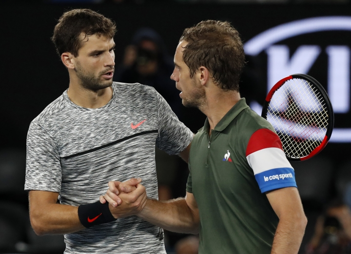 Bulgaria's Grigor Dimitrov, left, is congratulated by France's Richard Gasquet after winning their third round match during their third round match at the Australian Open tennis championships in Melbourne, Australia, Sunday, Jan. 22, 2017. (AP Photo/Kin Cheung)