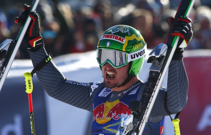 Italy's Dominik Paris celebrates after completing an alpine ski, men's World Cup downhill, in Kitzbuehel, Austria, Saturday, Jan. 21, 2017. (AP Photo/Giovanni Auletta)