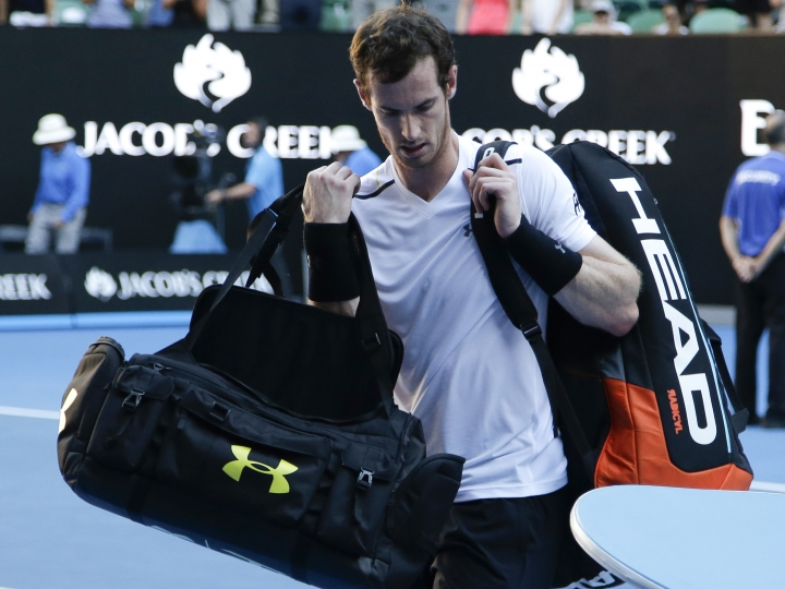 Britain's Andy Murray carries his bags from the court following his fourth round loss to Germany's Mischa Zverev at the Australian Open tennis championships in Melbourne, Australia, Sunday, Jan. 22, 2017. (AP Photo/Mark Baker)