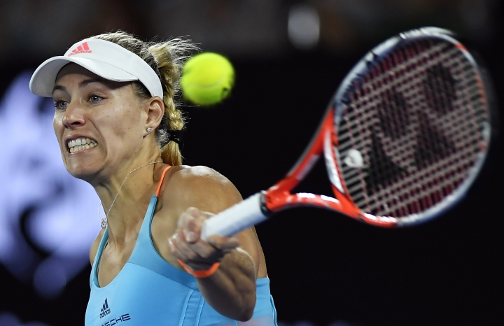 Germany's Angelique Kerber makes a forehand return to United States' Coco Vandeweghe during their fourth round match at the Australian Open tennis championships in Melbourne, Australia, Sunday, Jan. 22, 2017. (AP Photo/Andy Brownbill)