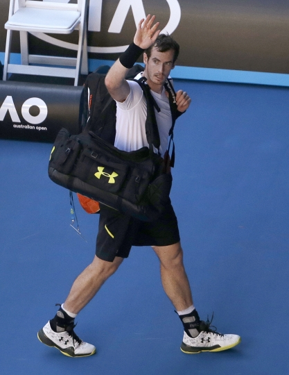 Britain's Andy Murray waves as he walks off the court after losing to Germany's Mischa Zverev in their fourth round match at the Australian Open tennis championships in Melbourne, Australia, Sunday, Jan. 22, 2017. (AP Photo/Dita Alangkara)