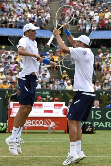 FILE- In this March, 2016 file photo, Bob Bryan, left, and his brother Mike of the United States celebrate after defeating Australia's Lleyton Hewitt and John Peers in their Davis Cup doubles match in Melbourne, Australia. Bob and Mike Bryan announced Sunday, January, 22, 2017, that they are retiring from playing Davis Cup for the United States after 14 years with the team. (AP Photo/Andrew Brownbill,File)