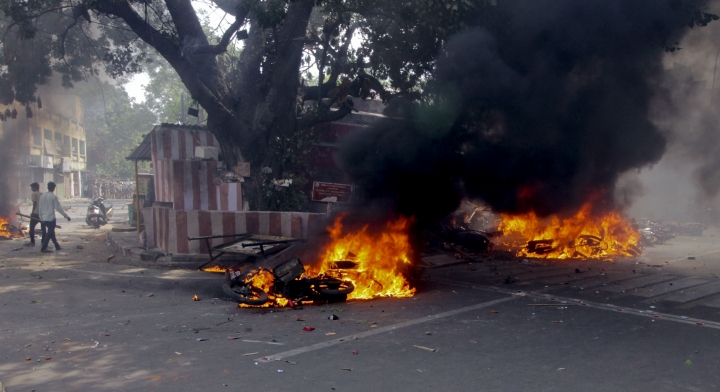 Two wheelers suspected to be set on fire by protestors go up in flames in Chennai, India, Monday, Jan.23, 2017. Fans of Jallikattu, a traditional bull-taming ritual attacked a police station with stones and set some vehicles on fire Monday in anger at being forcibly evicted from the beach where they been protesting for the past week in support of the sport. Jallikattu involves releasing a bull into a crowd of people who attempt to grab it and ride it. It is popular in Tamil Nadu state, but India's top court banned it in 2014 on grounds of animal cruelty. (AP Photo)