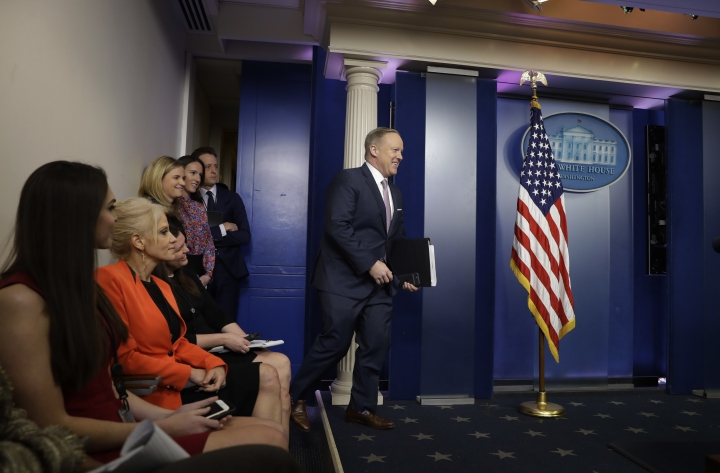 White House press Secretary Sean Spicer arrives in the briefing room of the White House in Washington, Monday, Jan. 23, 2017, for the daily White House briefing. (AP Photo/Evan Vucci)