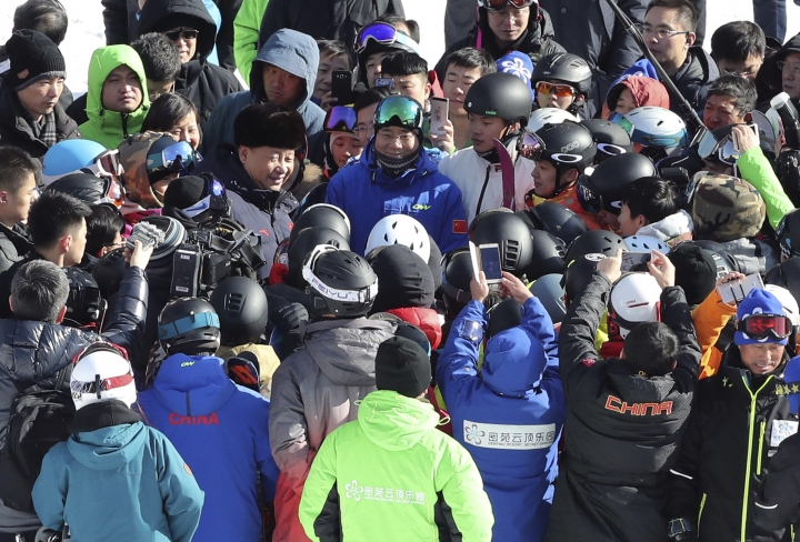 In this Jan. 23, 2017 photo released by Xinhua News Agency, Chinese President Xi Jinping meets members of the the national skiing team and other skiers at the Genting Ski Resort as he inspects preparatory work for the Beijing 2022 Winter Olympic Games in Zhangjiakou in northern China's Hebei Province. Xi stressed the need for sustainability and post-event planning on the visit to ski venues for the 2022 Beijing Winter Olympics.(Wang Ye/Xinhua via AP)