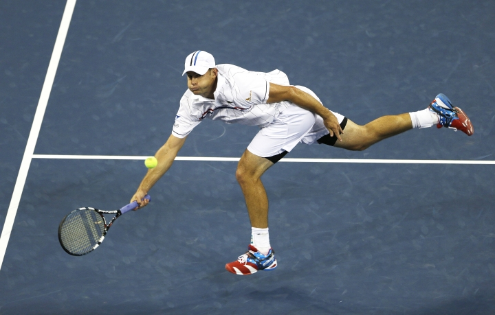 FILE - In this Aug. 31, 2012, file photo, Andy Roddick returns a shot to Australia's Bernard Tomic in the third round of play at the 2012 US Open tennis tournament in New York. Roddick and Kim Clijsters have been elected to the International Tennis Hall of Fame. (AP Photo/Mike Groll, File)