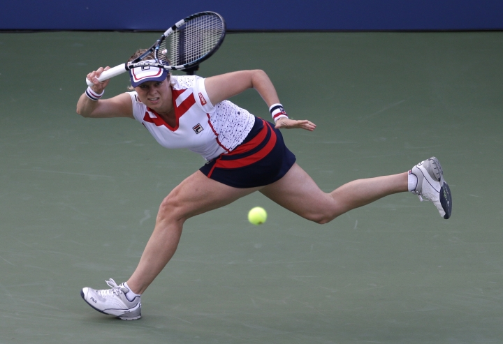 FILE - In this Aug. 29, 2012, file photo, Kim Clijsters of Belgium returns a shot to Laura Robson of Great Britain in the second round of play at the 2012 US Open tennis tournament, in New York. Clijsters and Andy Roddick have been elected to the International Tennis Hall of Fame. (AP Photo/Darron Cummings, File)