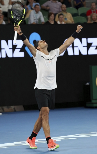 Spain's Rafael Nadal celebrates after defeating France's Gael Monfils in their fourth round match at the Australian Open tennis championships in Melbourne, Australia, Monday, Jan. 23, 2017. (AP Photo/Aaron Favila)