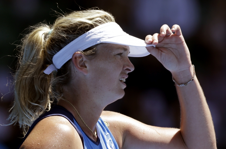 United States' Coco Vandeweghe adjusts her visor while playing Spain's Garbine Muguruza during their quarterfinal at the Australian Open tennis championships in Melbourne, Australia, Tuesday, Jan. 24, 2017. (AP Photo/Aaron Favila)