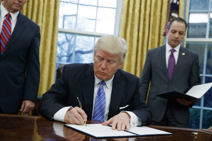 FILE - In this Monday, Jan. 23, 2017, file photo, President Donald Trump signs an executive order to withdraw the U.S. from the 12-nation Trans-Pacific Partnership trade pact agreed to under the Obama administration in the Oval Office of the White House in Washington. With his rejection of an Asian trade pact, Trump has started tackling policy changes that could inadvertently give China room to assert itself as a regional leader and worsen strains over the South China Sea and Taiwan. (AP Photo/Evan Vucci, File)