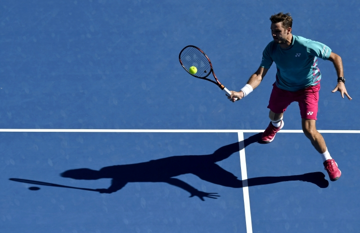 Switzerland's Stan Wawrinka makes a forehand return to France's Jo-Wilfried Tsonga during their quarterfinal at the Australian Open tennis championships in Melbourne, Australia, Tuesday, Jan. 24, 2017. (AP Photo/Andy Brownbill)