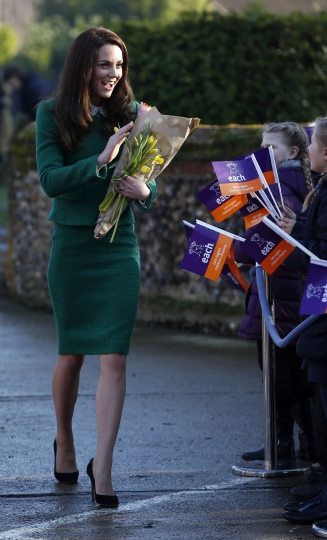 Britain's Kate, Duchess of Cambridge meets local school children as she arrives to visit East Anglia's Children's Hospices (EACH) in Quidenham, near Norwich, eastern England, Tuesday Jan. 24, 2017. The Duchess toured the facilities of the hospice and met families who use the services at Quidenham. EACH offers support to families, and care for children and young people with life-threatening conditions in Norfolk. (Adrian Dennis/Pool via AP)