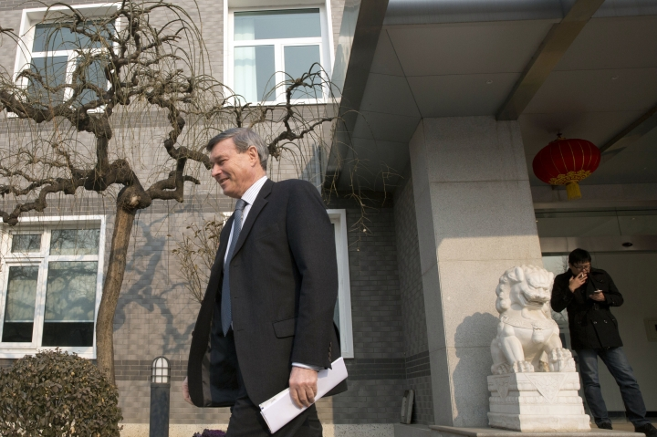 European Union ambassador to China Hans Dietmar Schweisgut at left walks to a press conference in Beijing, China, Wednesday, Jan. 25, 2017. The European Union ambassador to China has welcomed its endorsement of free trade in the face of U.S. President Donald Trump's promise to restrict imports and appealed to Beijing to lower its own market barriers. (AP Photo/Ng Han Guan)